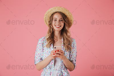 Portrait of a cheerful young woman in summer dress
