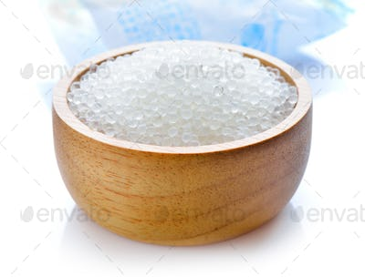 Silica gel in wood bowl on white background