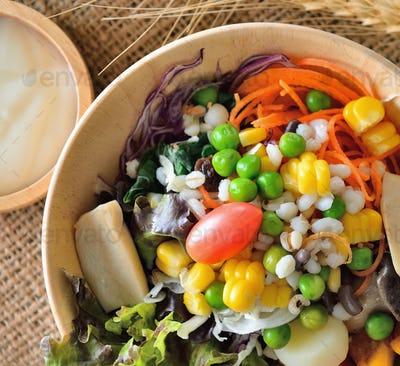 bowl of salad with vegetables  on wooden table