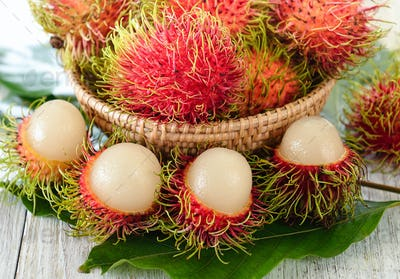 Fresh rambutans in wood bowl