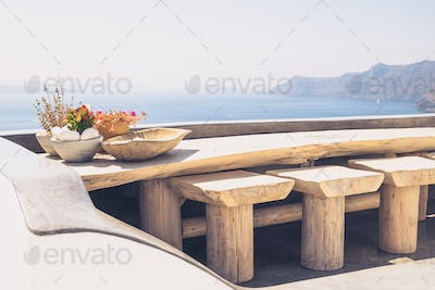 Beautiful vintage wooden table and chairs on terrace, Santorini