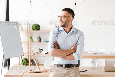 Portrait of business man or office worker 30s wearing white shir