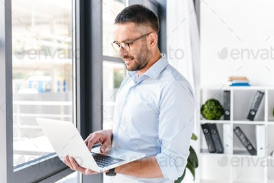 Attractive office man wearing white shirt expressing success, wh