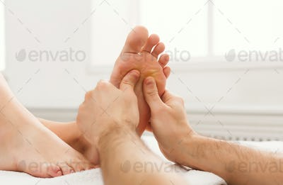 Feet massage closeup, acupressure