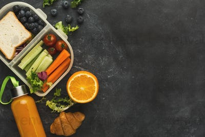 Lunch box with healthy food on black table background