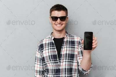 Portrait of a smiling young man in sunglasses