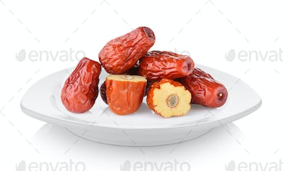 Dried red date or Chinese jujube in white plate on white backgro