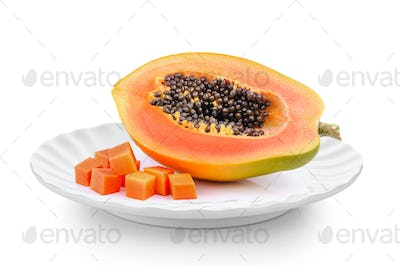 ripe papaya in a plate isolated on a white background