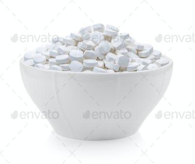 pills bowl on white background