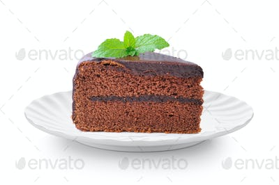 piece of chocolate cake in white plate on white background