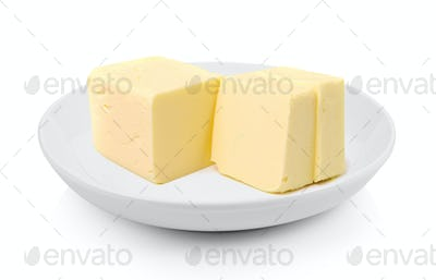 Stick of butter in a plate on white background