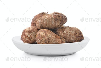taro root in plate on white background