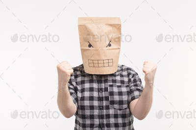 Angry man in paper bag mask punching