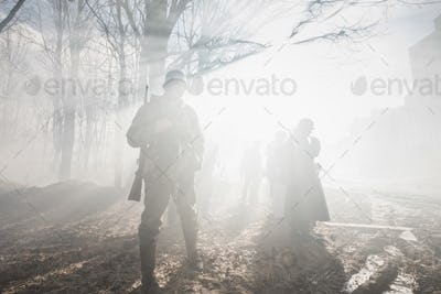 Re-enactors Dressed As German Wehrmacht Infantry Soldier In Worl