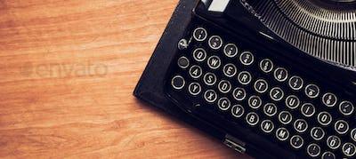 Vintage typewriter machine on writers desk