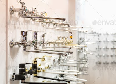 Rows of new faucets for bathroom in plumbing shop