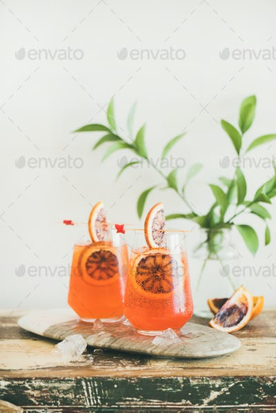 Glasses of Aperol Spritz alcohol cocktail with orange and ice