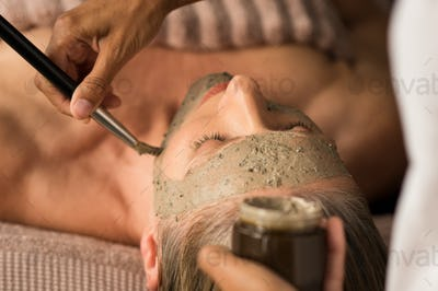 Beauty mud mask on face
