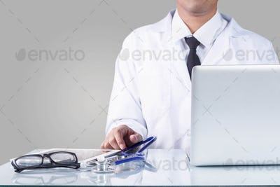 Doctor and equipment in office