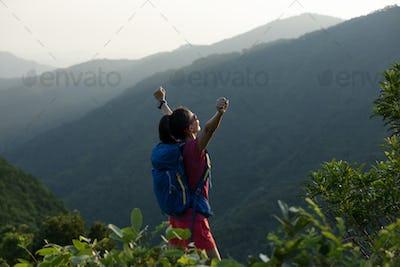 Hiking on sunrise mountain top