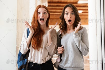 Pretty surprised excited ladies students