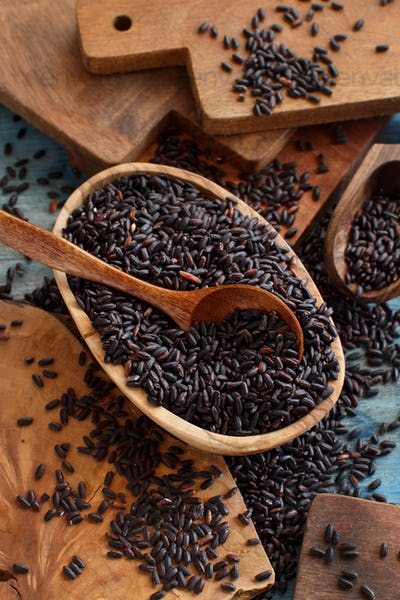 Black rice in a bowl with a spoon