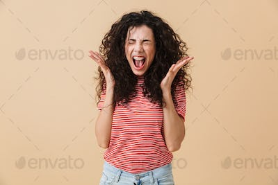Agressive displeased screaming young woman