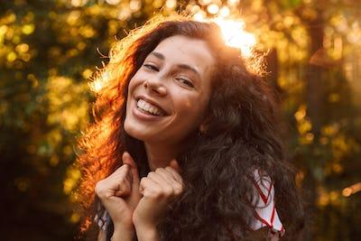 Happy young pretty woman make winner gesture