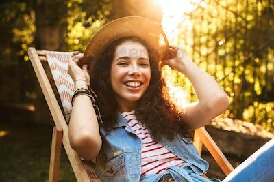 Photo of beautiful young brunette woman 18-20 wearing straw hat,