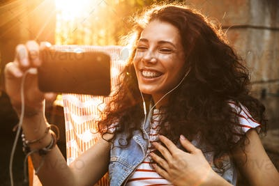 Photo of young european woman 18-20 smiling and speaking on vide