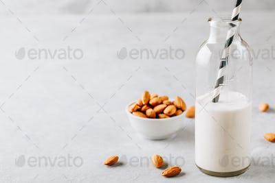 Homemade almond milk in a glass bottle.