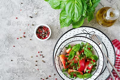 Tomato salad with basil and pine nuts in bowl