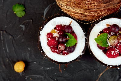 Fruit salad in coconut shell bowl