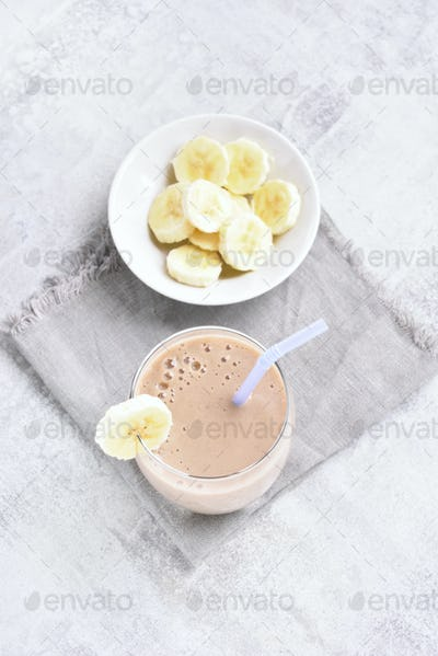 Healthy beverage. Banana smoothie in glass