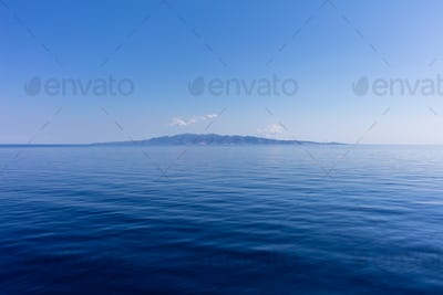 Blue sky and calm ocean sea water background