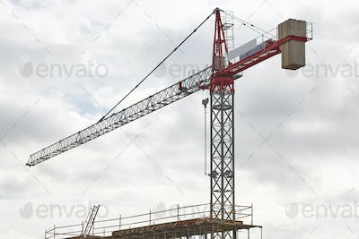 Building in progress and crane machinery structure. Construction industry. Horizontal