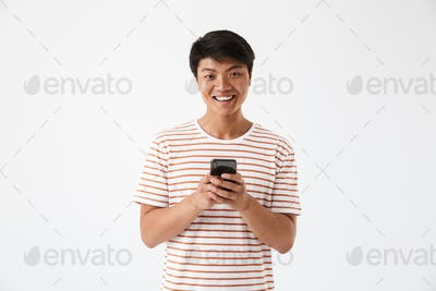 Portrait of a cheerful asian man holding mobile phone