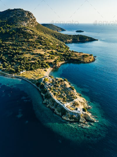 Aerial view of rocks and blue sea lagoon in Greece