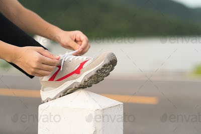 Woman tying shoelace his before starting running-4
