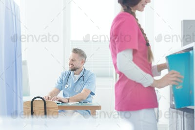 Smiling gynecologist using computer