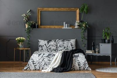Luxurious dark interior with bed