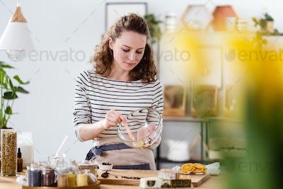 Vegan woman mixing natural ingredients