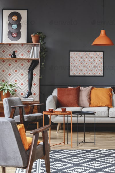 Retro living room interior with armchairs, sofa decorated with o