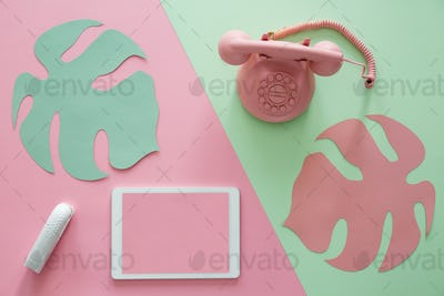 Tablet on pink background