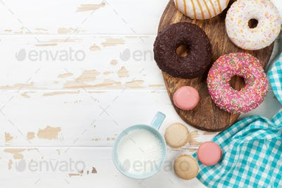 Milk and donuts on wooden table