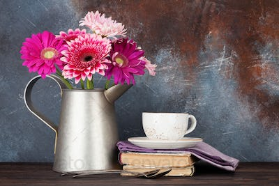 Gerbera flowers bouquet and coffee cup