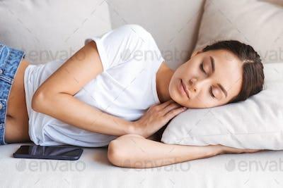 Pretty young asian woman sleeping