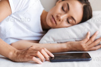 Pretty young asian woman sleeping on couch at home