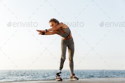 Full length of motivated disabled athlete woman