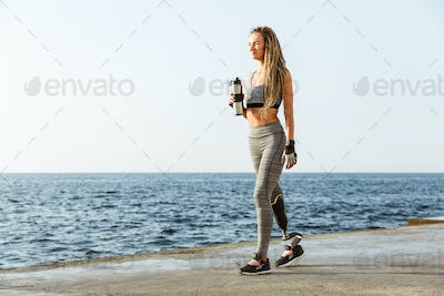 Full length of young disabled athlete woman